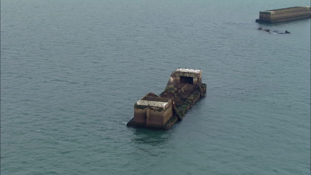 mulberry harbour - aerial view - lower normandy, orne, arrondissement de mortagne-au-perche, france - d day stock videos and b-roll footage
