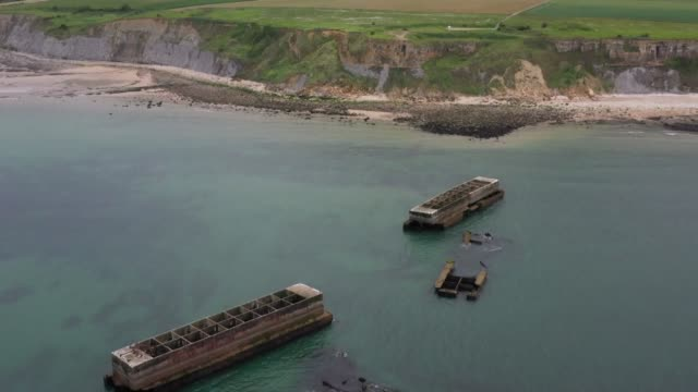 vídeos de stock, filmes e b-roll de mulberry was the code name for artificial ports built by the allies off saintlaurentsurmer and arromanches which allowed hundreds of thousands of... - arromanches