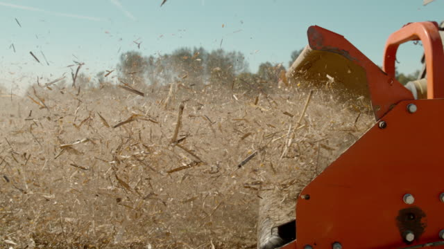 slo mo ms mulching corn stalks - agricultural machinery stock videos & royalty-free footage