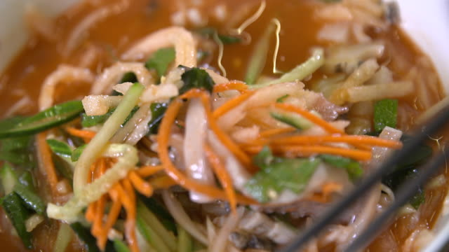 Mulhoe (Cold raw fish soup) with slices of abalone in the bowl (Korean food)