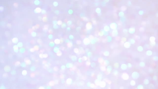 multi colored and defocused glitter exploding towrds camera, shining bokeh - fiesta background stock videos & royalty-free footage