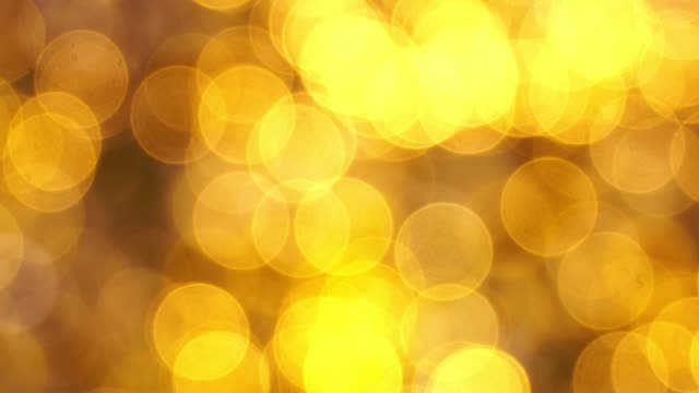 multi colored bokeh abstract background for christmas and new year events. - gelb stock-videos und b-roll-filmmaterial