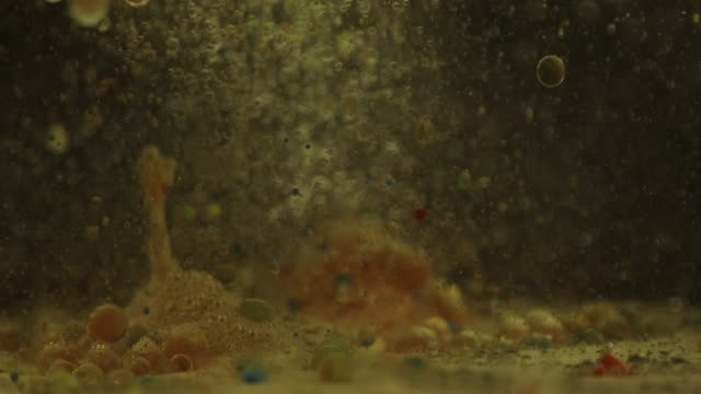 multi colored bubbles under water - magnification stock videos & royalty-free footage