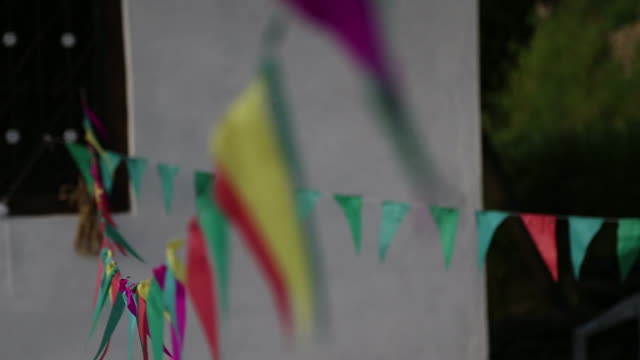 multi colored bunting hanging on string - kite toy stock videos and b-roll footage