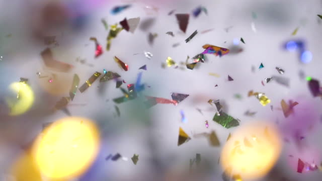 multi colored confetti falling on white background - pavimento video stock e b–roll