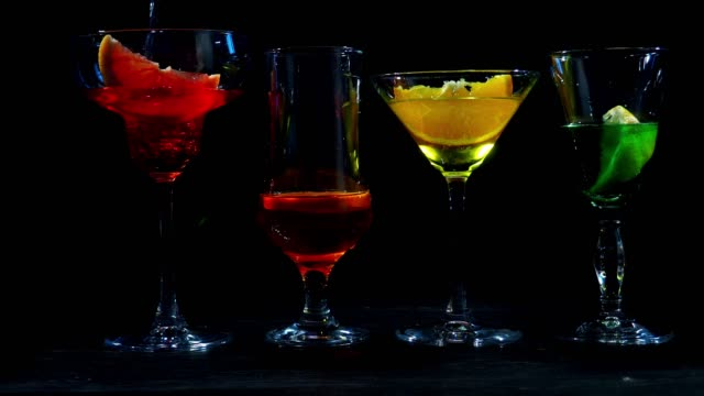 multi colored drinks in cocktail glasses - margaritas stock videos and b-roll footage