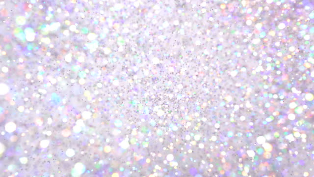 multi colored glitter exploding towards camera and becoming defocused, shining bokeh - flitter stock-videos und b-roll-filmmaterial