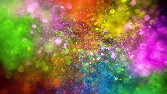 multi colored glitter exploding towards camera and becoming defocused, shining bokeh on black background - glamour stock-videos und b-roll-filmmaterial
