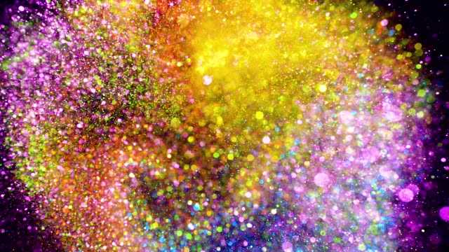 multi colored glitter exploding towards camera and becoming defocused, shining bokeh on black background - scintillante video stock e b–roll