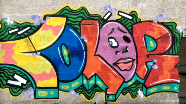 multi colored graffiti on wall - graffiti stock videos & royalty-free footage