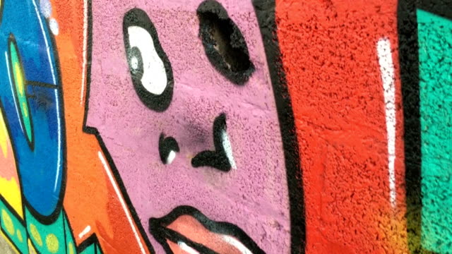 multi colored graffiti on wall - graffiti stock videos and b-roll footage