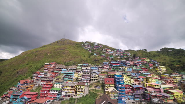multi colored slums at a mountain of philippines. baguio city - フィリピン点の映像素材/bロール