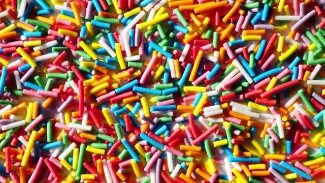 multi colored sprinkles - sprinkles stock videos & royalty-free footage