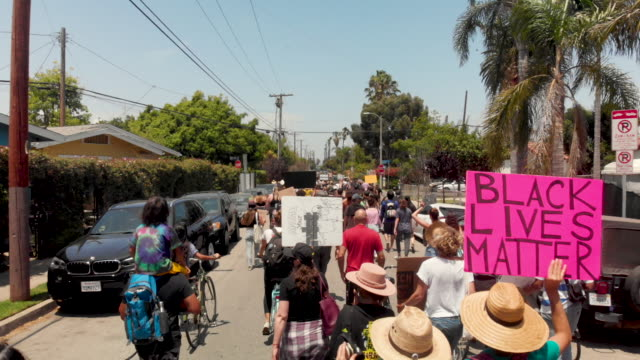 multi ethnic all ages male and female protesters marching in the streets - black history in the us stock videos & royalty-free footage