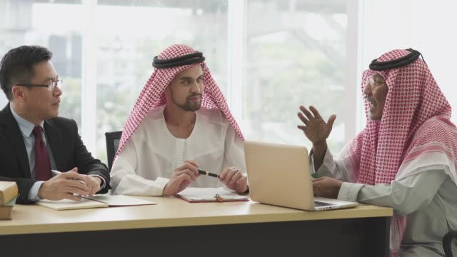 multi ethnic businessmen having conversation in the meeting - middle eastern culture stock videos & royalty-free footage