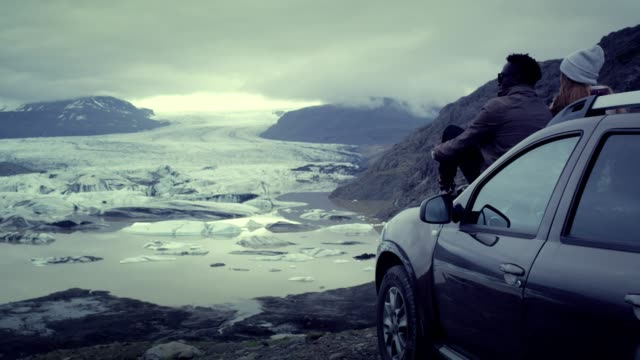 multi ethnic couple enjoying amazing view. glacier lagoon - sports utility vehicle stock videos & royalty-free footage