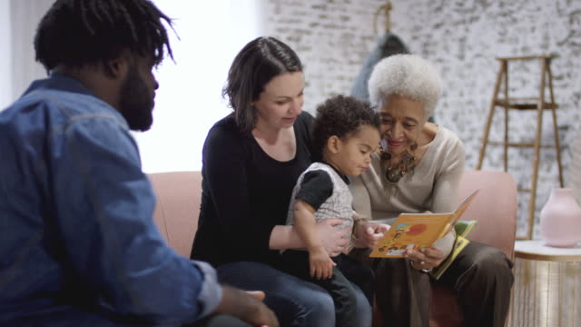 multi ethnic family reading - ethnicity stock videos & royalty-free footage