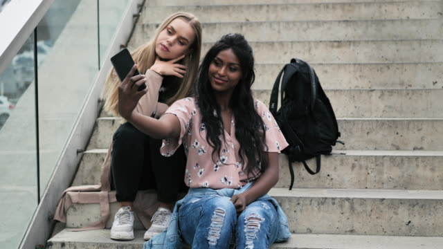 multi ethnic female friends with perfect smiles taking selfie - cultures stock videos & royalty-free footage