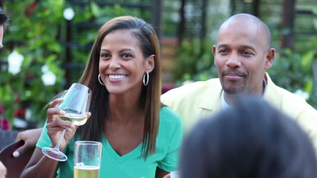 cu multi ethnic friends at backyard barbecue. - white wine stock videos & royalty-free footage