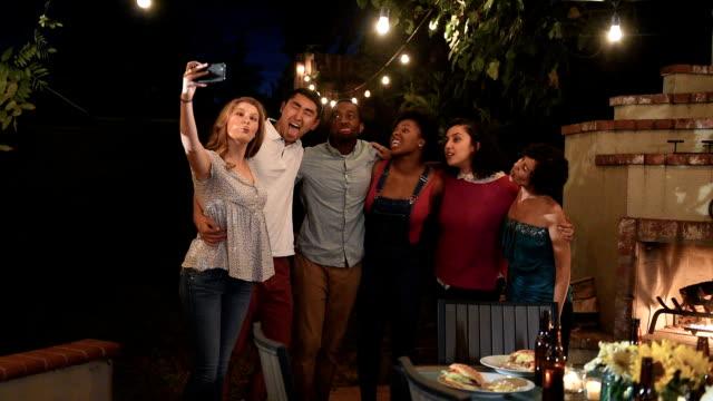 Multi Ethnic Friends Take a Group Selfie