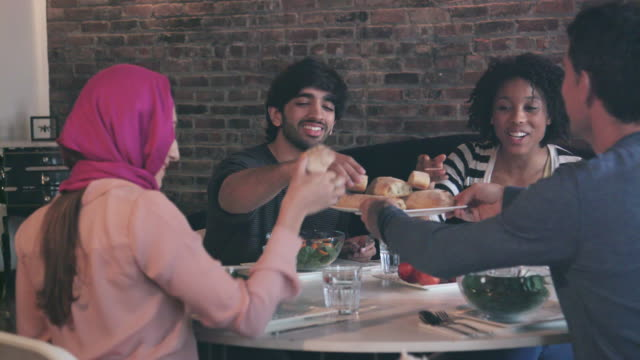 Multi Ethnic Group of Friends Enjoy Meal Together