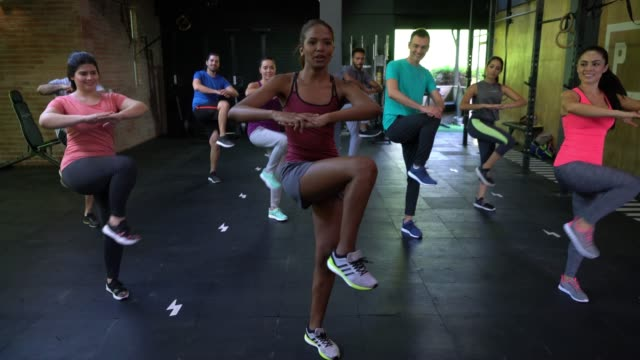 multi ethnic group of people in class at the gym - aerobics stock videos & royalty-free footage