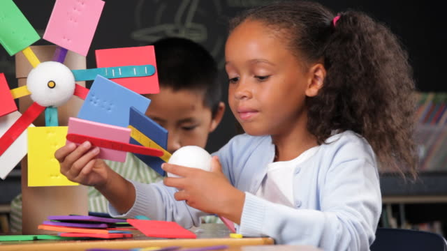 R/F Multi Ethnic Group of School Children Making Model Windmills / Richmond, Virgnia, USA