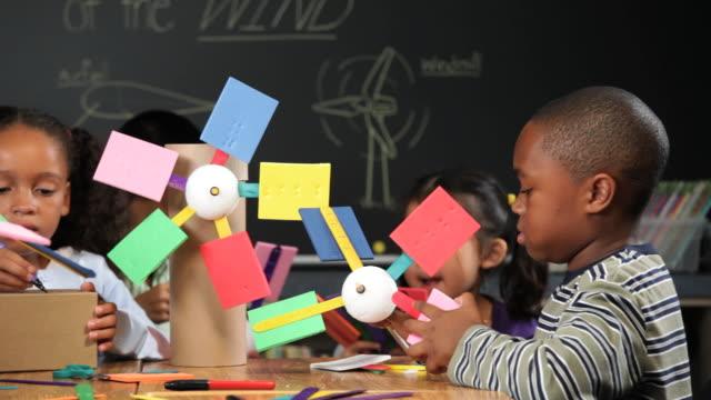 MS Multi Ethnic Group of School Children Making Model Windmills / Richmond, Virgnia, USA