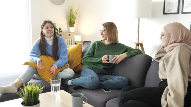 multi ethnic group of young women having meet up at home. - 18 19 years stock videos & royalty-free footage
