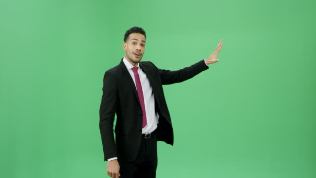 Multi ethnic man in a dark suit presenting weather news