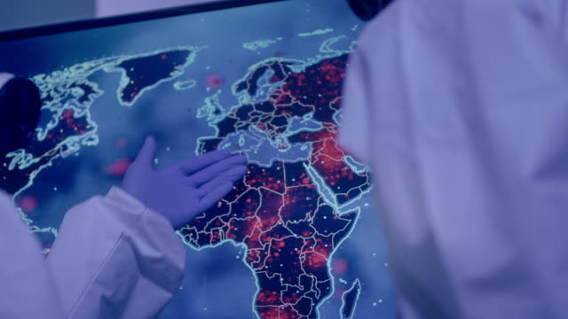multi ethnic scientists in laboratory. infection map of the world. first outbreaks of disease in africa. pointing italy - biomedical illustration stock videos & royalty-free footage