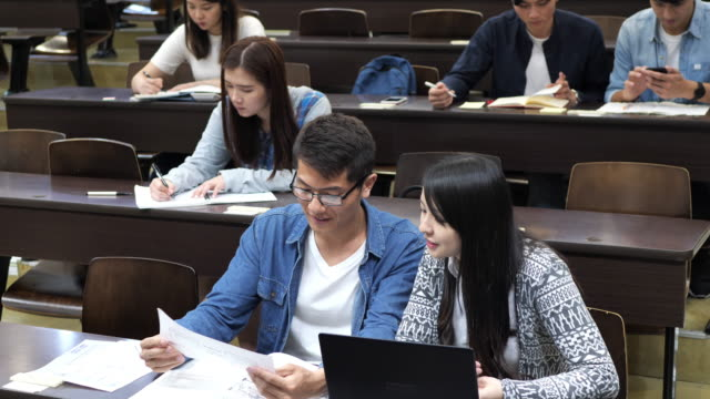 multi ethnic students doing exam in lecture hall - chinese ethnicity stock videos & royalty-free footage