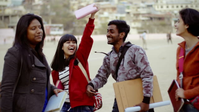 multi ethnic students doing fun in college campus. - hill stock videos & royalty-free footage