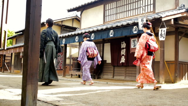 Multi Generation Family Dressed in Traditional Costume in an Edo Era Japanese Village
