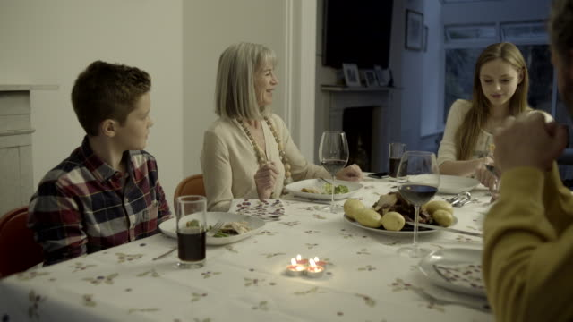 multi generation family together for meal at home - nipote maschio video stock e b–roll