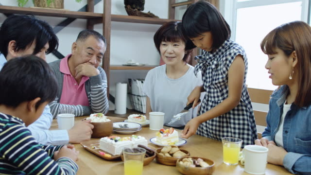 multi generation japanese family having cake - dining table stock videos & royalty-free footage