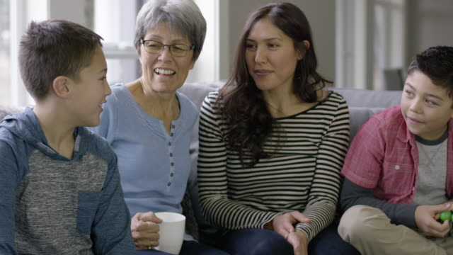 Multi Generational Ethnic Family Chatting on a Couch