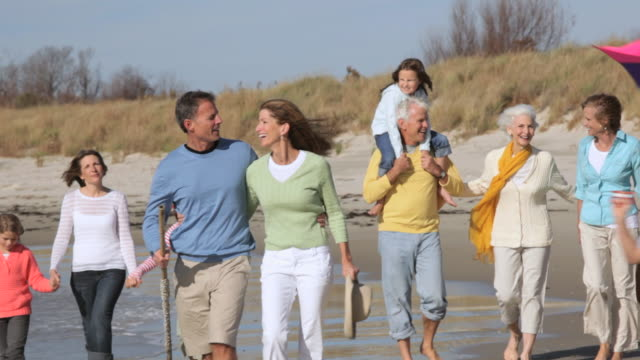 WS TS Multi Generational Family Walking Along Beach Together / Eastville, Virginia, USA