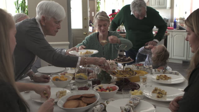 multi generations family dinner - large family stock videos & royalty-free footage