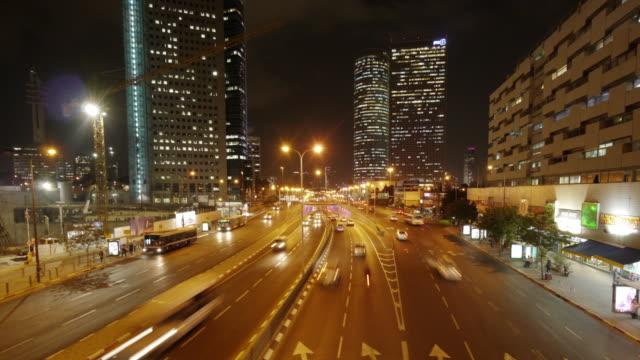 multi lane city highway at night in urban tel aviv - time lapse - tel aviv stock videos & royalty-free footage