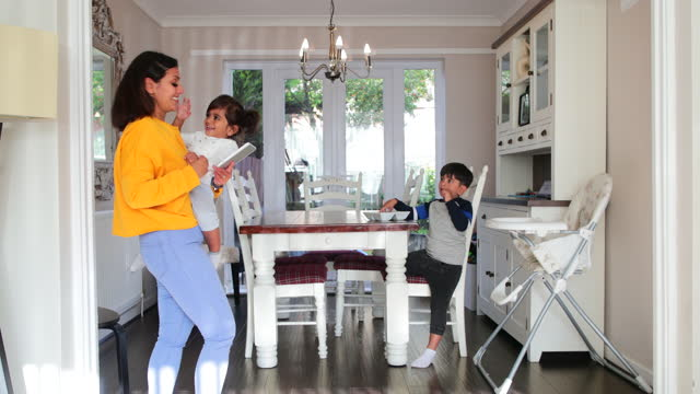 multi tasking mum - dining room stock videos & royalty-free footage