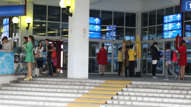 A multiclip showing the trilingual welcome sign to Macau and the arrival from Hong Kong at the ferry terminal at the Fisherman's Wharf in Macau