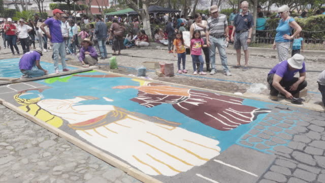 multicolor carpet for lent / easter celebration made by young people at antigua guatemala - easter stock videos & royalty-free footage