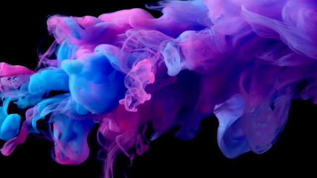 slow-mo: multicolor liquid flow - inchiostro video stock e b–roll