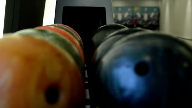 Multi-colored bowling balls and machine
