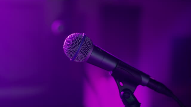 ds multicolored lights illuminating a microphone - microphone stock videos and b-roll footage