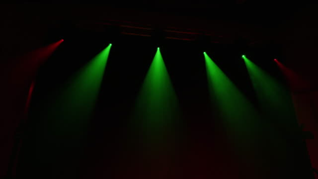 ws multicolored lights illuminating a stage - stage performance space stock videos & royalty-free footage