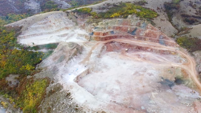 AERIAL: Multicolored marble open-pit mine