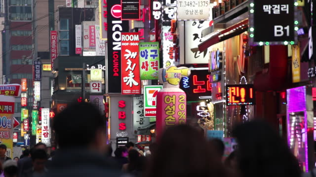 ms multicolored neon signs on crowded street at night / seoul, south korea - south korea stock videos & royalty-free footage