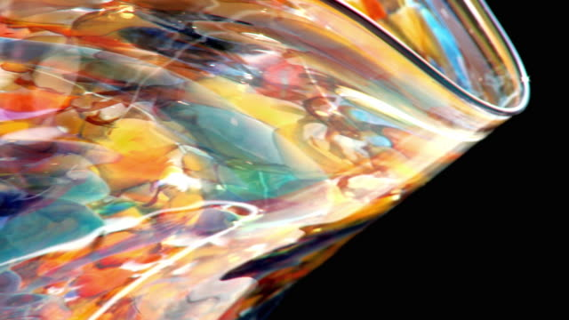 ecu multicolored piece of art glass rotating against black background - vase stock videos & royalty-free footage